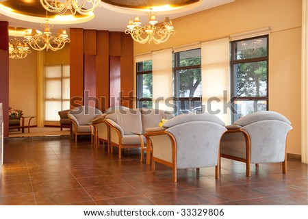 Modern interior of a hall with a soft zone - stock photo
