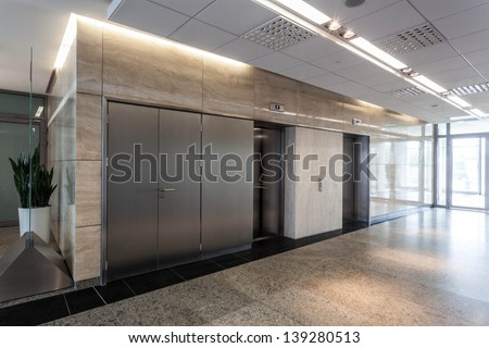 Modern interior of office, corridor and lift - stock photo