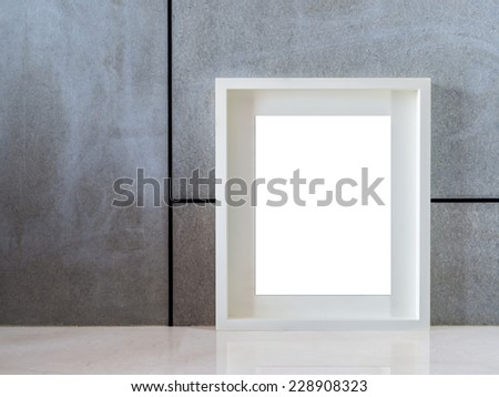 Modern interior wall background with blank black picture frame - stock photo