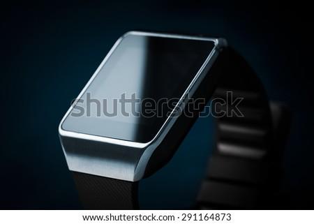 Modern internet smart watch on a black background. - stock photo