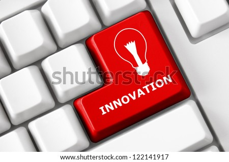 Modern keyboard Innovation text and electric lamp symbol. Technology concept - stock photo