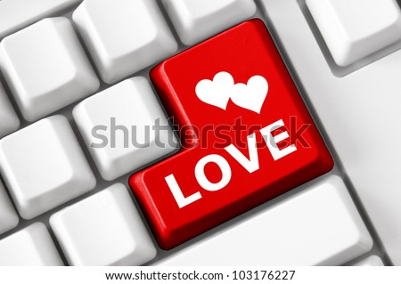 Modern keyboard with love text and heart symbols. Social network concept - stock photo
