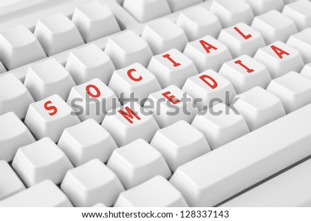 Modern keyboard with social media button - stock photo
