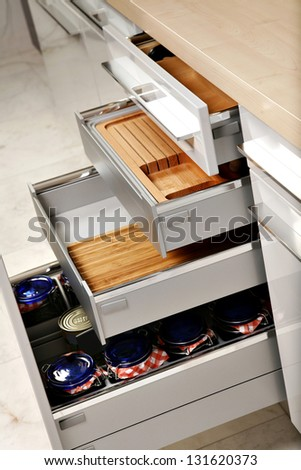 Modern kitchen drawers with compartments for various things. - stock photo