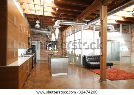 Modern kitchen in a huge loft - stock photo