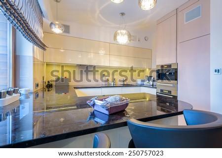 Modern kitchen in modern city apartment in Krakow, Poland - stock photo