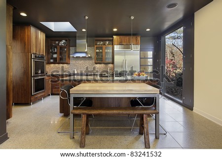 Modern kitchen in suburban home with large picture window - stock photo