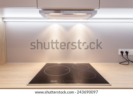 Modern kitchen Induction cooking heats and lights - stock photo