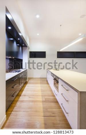 Modern kitchen interior in luxury house - stock photo