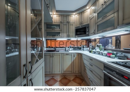 Modern kitchen interior with a view to a living room - stock photo