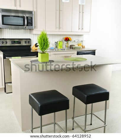 Modern kitchen interior with island and natural stone countertop - stock photo