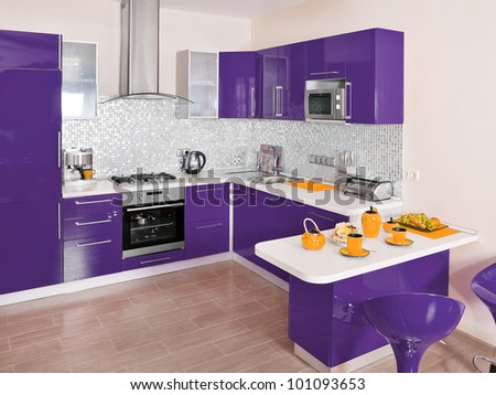 Modern kitchen interior with violet decoration - stock photo