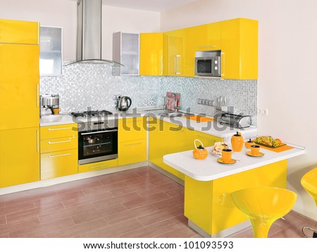 Modern kitchen interior with yellow decoration - stock photo