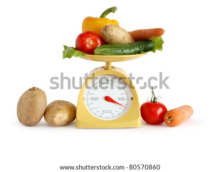 Modern kitchen scale and vegetables on white background. Isolated with clipping path - stock photo