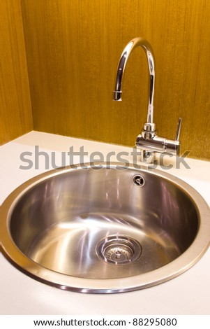 modern kitchen sink with stainless steel basin - stock photo