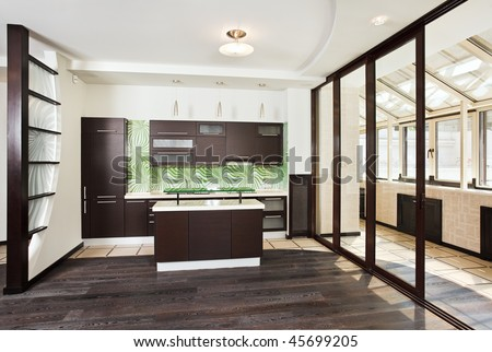 Modern kitchen (studio) interior with balcony and dark Wooden floor, front wide angle view - stock photo