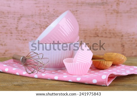 Modern kitchen utensils for baking on color wooden background - stock photo