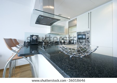 modern kitchen with appliances and extractor fan - stock photo