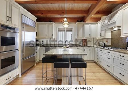 Modern kitchen with center island - stock photo