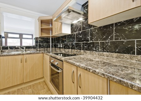 modern kitchen with granite worktop and serving window - stock photo
