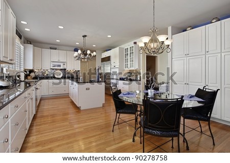 Modern kitchen with island and eating area - stock photo