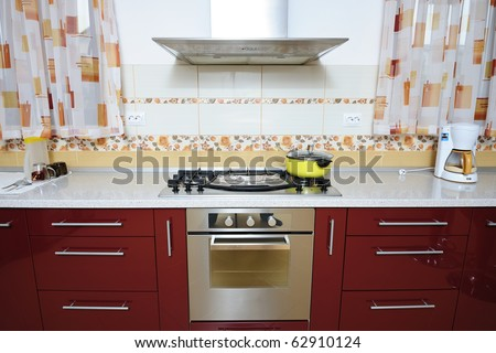 Modern kitchen with oven in the center - stock photo