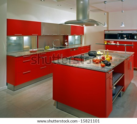 modern kitchen with red cupboard - stock photo