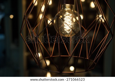 modern lamp from metal with Edison bulb - stock photo