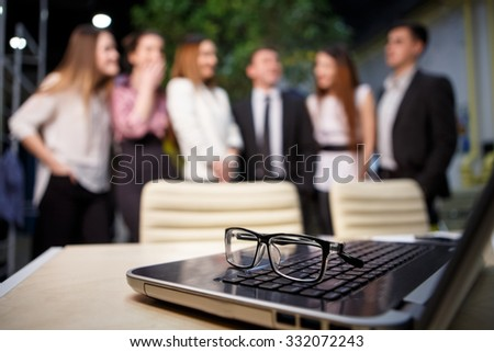 modern laptop computer with his team in background - stock photo