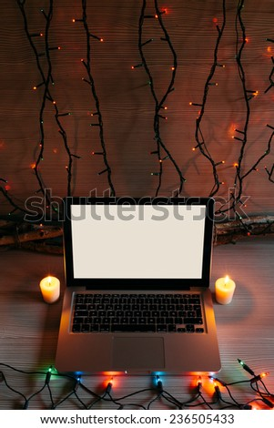 Modern Laptop in a Christmas Setting - stock photo