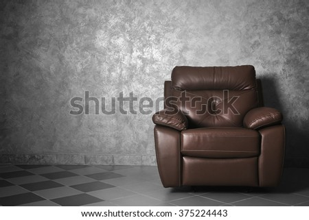 Modern leather chair in the living room, close up - stock photo