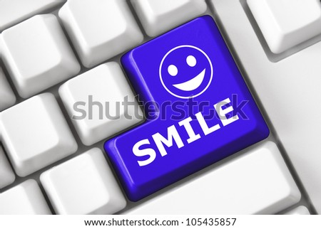Modern light keyboard with button Smile - stock photo