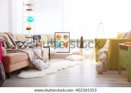 Modern living room design with sofa and armchair - stock photo