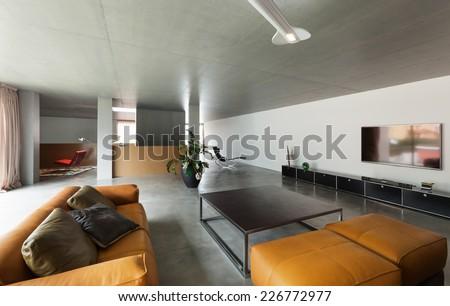 Modern living room, interior house, concrete walls   - stock photo