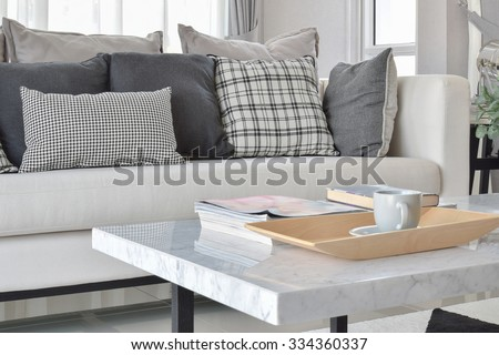 modern living room interior with black and white checked pattern pillows and carpet - stock photo