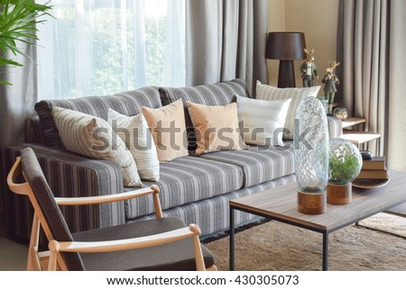 modern living room interior with striped pillows on a casual sofa at home - stock photo
