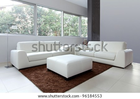 Modern living room interior with white furniture - stock photo