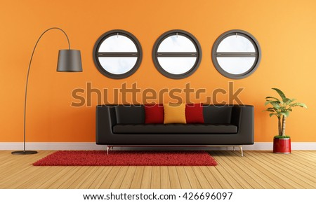 Modern living room with black couch and round windows -3d rendering - stock photo