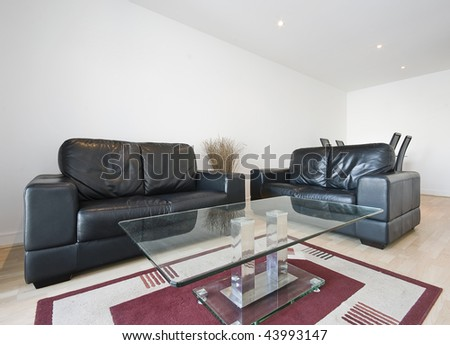 modern living room with chunky black leather sofa - stock photo
