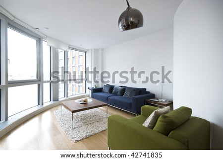 modern living room with floor to ceiling windows and designer furniture - stock photo