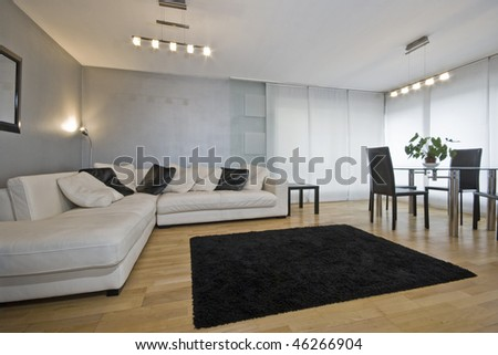 modern living room with metallic paint and luxury corner sofa - stock photo