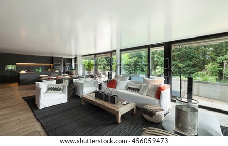 Modern living room with white divans and big windows - stock photo