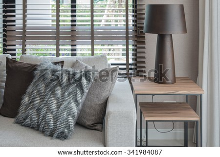 modern living room with wooden lamp on wooden table side - stock photo
