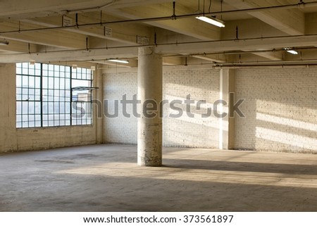 Modern Loft Apartment Warehouse Interior - stock photo