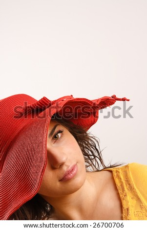 Modern looking young woman wearing a red hat - stock photo