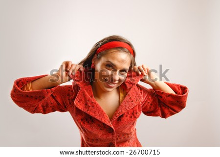 Modern looking young woman wearing a red jacket - stock photo