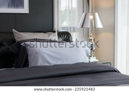 modern luxury bedroom with pillows and lamp - stock photo