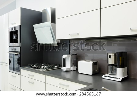 Modern luxury black and white kitchen, clean interior design - stock photo