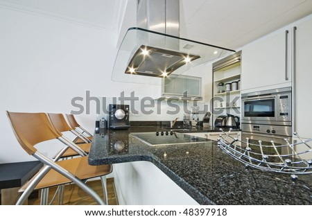 modern luxury designer kitchen with breakfast bar - stock photo