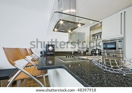 modern luxury designer kitchen with breakfast bar - stock photo